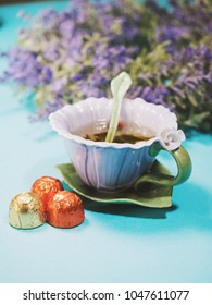 Handmade beautiful flower cup of fragrant tea violet porcelain and candies
