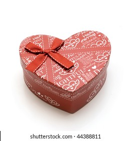 hand-made beautiful red heart gift box in white background