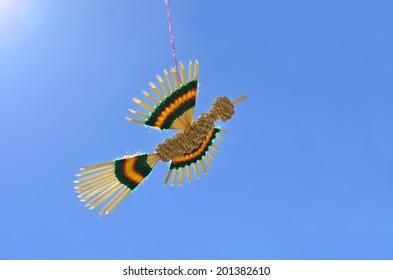 Handmade bird hanging by a thread