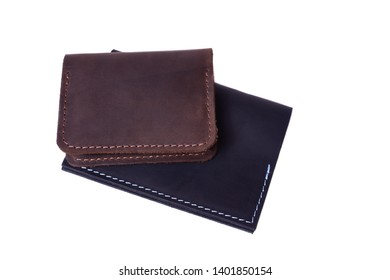Handmade brown cardholder and black passport cover isolated on white background closeup. Stock photo of handmade luxury accessories.