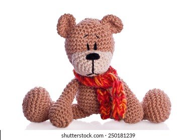 handmade brown teddy bear with a scarf