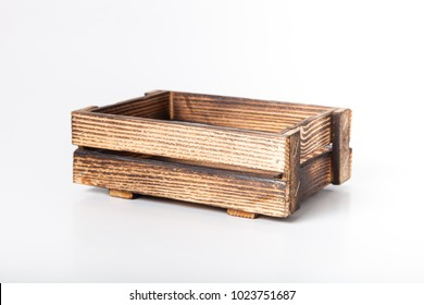 Handmade burned wooden box on a light background.