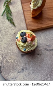 Handmade capcake with blueberries on wood background top view.