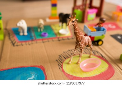 Handmade cardboard zoo for children with plastic toys animals.Education concept.Homeschooling game idea.Children creativity.Kids learning.Preschool game.Childhood concept.Children drawing.