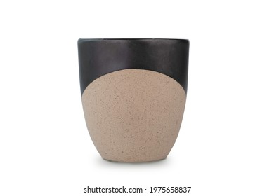 Handmade ceramic coffee mug or tea cup isolated on white background with clipping path. Coffee mug or tea cup is made of clay pottery or ceramic. Ceramic Coffee mug with handle and handcraft concept.