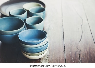 Handmade ceramic dishes on an old vintage table