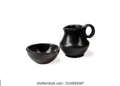 Handmade ceramic pitcher and bowl isolated on white background