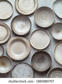 handmade ceramics, empty craft ceramic plates and bowls on light background, top view - Shutterstock ID 1885880707