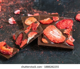 Handmade chocolate with pieces of freeze-dried, strawberry fruit and dry ice cream