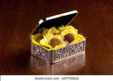 Handmade chocolate truffle on wooden background