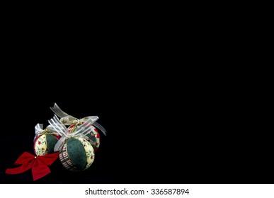 Handmade Christmas balls on black background