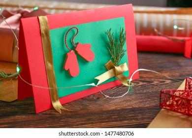 Handmade Christmas card on wooden table