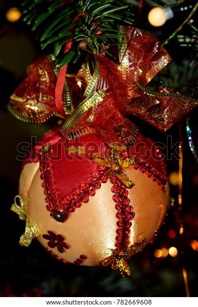 Elegant Handmade Christmas Ornaments.Handmade Christmas Decoration Elegant Red Gold Stock Photo