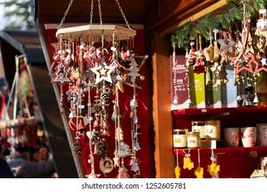 Handmade christmas decoration made out of wood, stars, christmas trees, bells, pinecone on a strap, on the christmas Market of Meran in South Tyrol Italy