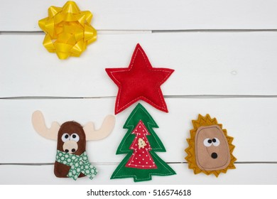 Handmade christmas Decoration Over White Wooden Background. Deer, Xmas Tree? Star and Swab over White Wood.