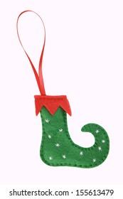 Handmade Christmas decorations: felt elf shoe isolated on white