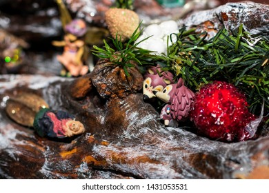 Handmade Christmas decorations inside a house. A wooden trunk is used to recreate the scene of a nativity scene with the addition of original objects like two porcupines.