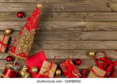 Handmade Christmas tree, ornaments and gifts on a gray wooden background.