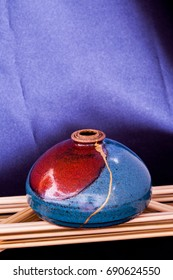 A handmade clay pot found in New Mexico then broken and rejoined by me using the Japanese art form of kintsugi. This has room at the top and bottom for text.