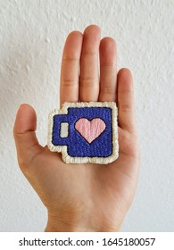 Handmade coffee cup mug patch with the colors blue and a centralized pink heart in it