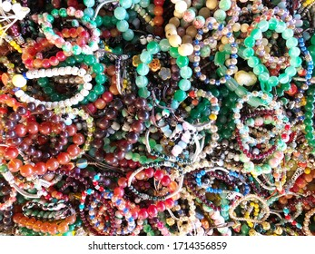 Handmade colorful bracelets from natural stones for sale in a local market