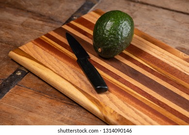 Handmade colorful, cutting board on a wooden table