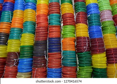 Handmade Colourful Glass bangles are worn by Indian or Pakistani girl, women as part of their beautification. it is also worn during wedding.