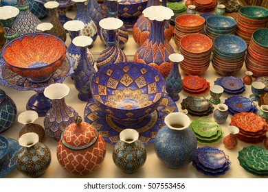 Handmade copper vases, plates and bowls handcrafted with colorful Persian enamel called Mina, traditionally made in Isfahan, Iran.