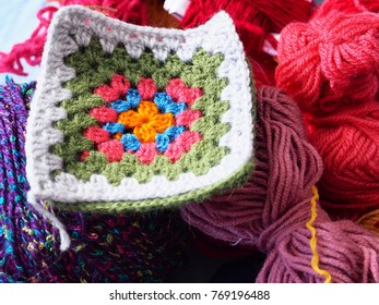 handmade corner with wool, cotton, crochet and crocheting tools
