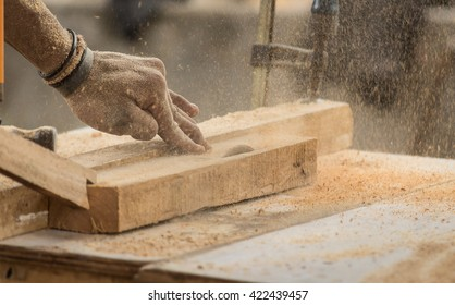 Handmade and craft furniture concept: Carpenter engaged in processing wood at the sawmill