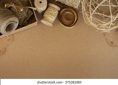 Handmade craft materials on cardboard background