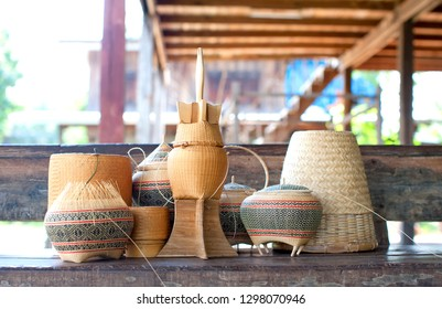 Handmade crafts of craftsman working basketry. Bamboo basketry made vase. Thai OTOP product from dry Hygaliepa grass weave as basketry.