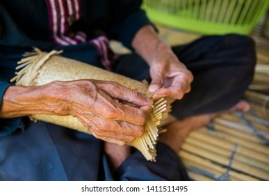 Handmade crafts of craftsman working basketry. Bamboo basketry made vase. Thai product from dry Hygaliepa grass weave as basketry. - Image