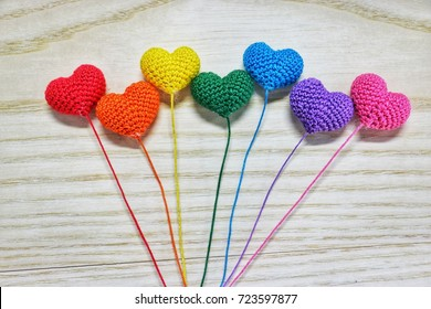 Handmade crochet heart on wooden background, Rainbow color, Love concept