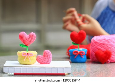 Handmade crochet heart and Woman with her crocheting