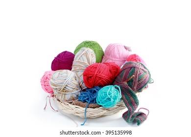 Handmade crochet, yarn in wooden basket isolated on white background