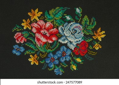 """Handmade cross-stitch """"Beautiful bouquet of roses, cornflowers, poppies on a black background """" is my own work"""