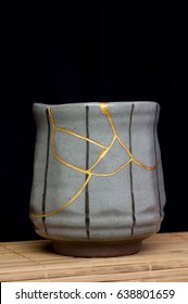 A handmade cup that was broken and repaired with the Japanese art form of kintsugi using gold to enhance the beauty of the broken piece and add to it's character as it continues it's existence.
