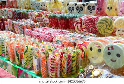 Handmade delicious colorful sweets - lollipops. Eco treat. Fair - an exhibition of folk craftsmen open air.