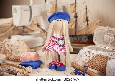 handmade doll in workplace.