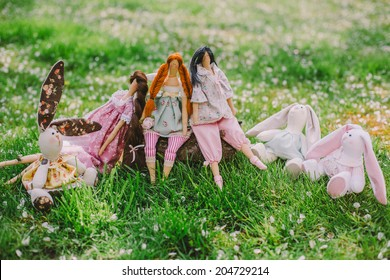 A handmade dolls on the grass background