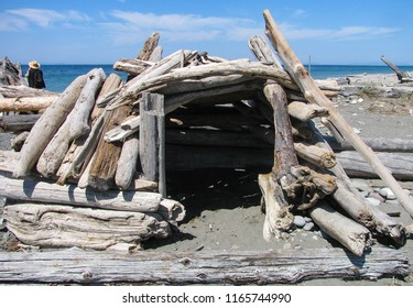 Handmade driftwood wind shelter on the beach at Dungeness Spit, a wildlife refuge and longest natural sand spit in the United States.