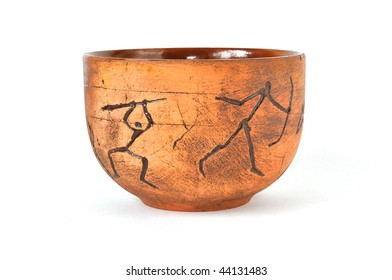 handmade earthenware cup in ancient art style, isolated on white