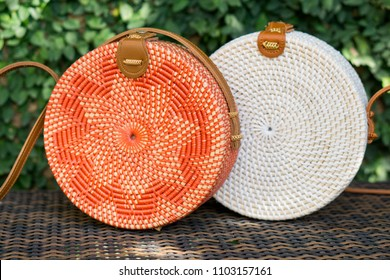 Handmade eco Bali bags from natural rattan on green background