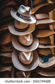 Handmade Ecuadorian Panama hats with black bands on display in a shop in Cuenca, Ecuador