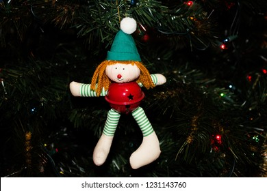 Handmade Elf Ornament with a Red Jingle Bell on a Christmas Tree