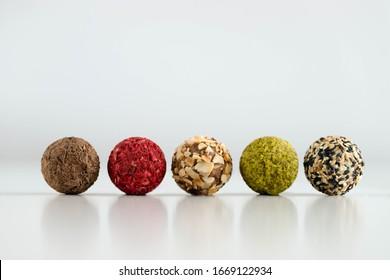 handmade energy balls, raw healthy dessert on a white background, snack