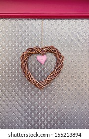 handmade faber and wicker decorative hearts over figured glass background
