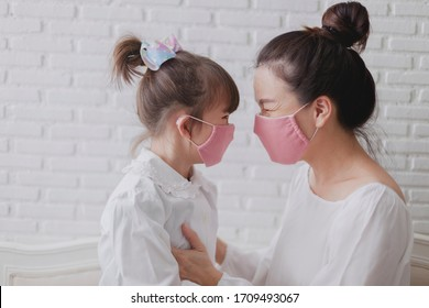 Handmade fabric mask for protect PM 2.5 and virus. Portrait. Mother and daughter are happy to wearing handmade fabric mask.