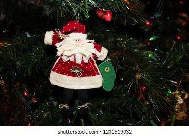 Handmade Fabric Santa Ornament hanging on a Christmas Tree